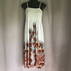 Strapless cream dress with orange and black print